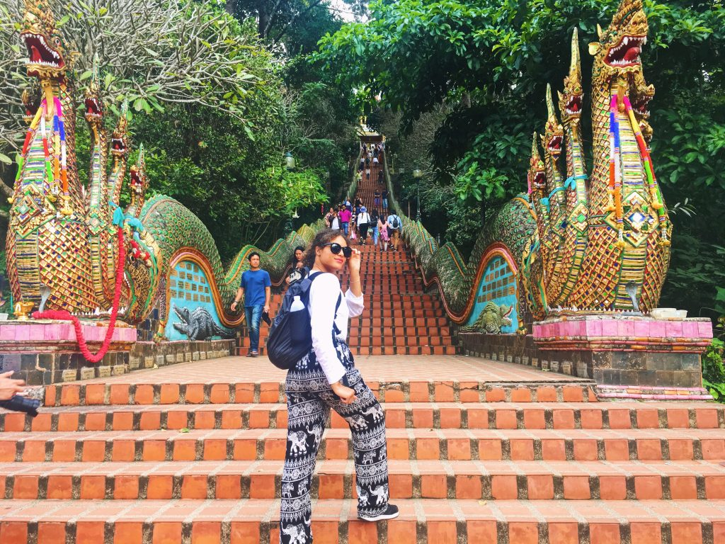 Standing in front of the tall, colorful staircase at Wat Doi Suthep in Chiang Mai Thailand