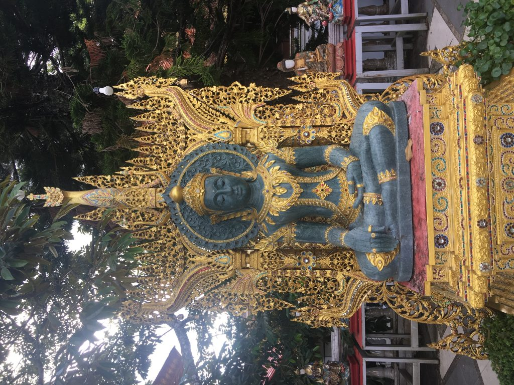Blue and gold Buddha statue at Wat Doi Suthep in Chiang Mai, Thailand.