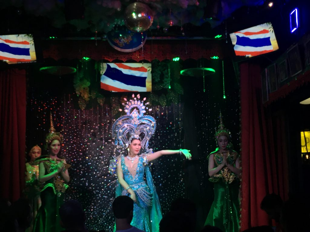 Photo of performer in sparkling dress and headpiece at Ram Bar cabaret in Chiang Mai, Thailand