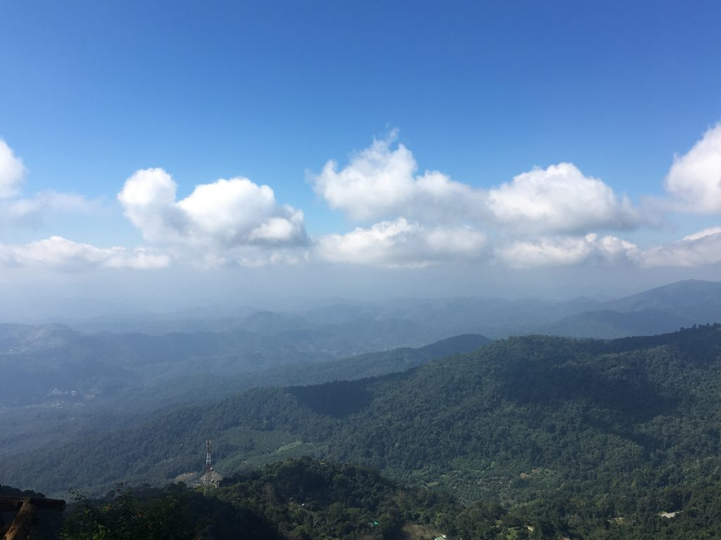 Beautiful viewpoint of rolling mountains and blue skies in Chiang Mai, Thailand.